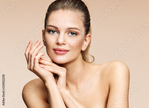 Obraz Beautiful girl with flawless skin on beige background. Youth and skin care concept - fototapety do salonu