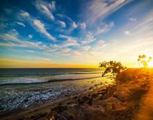 Malibu Beach Under A Colorful Sky At Sunset