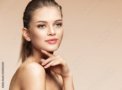 Fototapety, obrazy: Smiling girl touching her face. Photo of girl with flawless skin on beige background. Skin care and beauty concept
