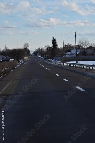 Fotografía  route dans le village en hiver