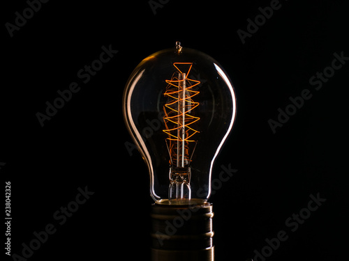 Photo  Edison's light bulb illuminates from electric current