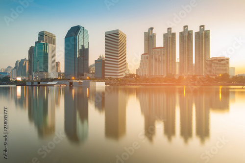 Spoed Foto op Canvas Stad gebouw Morning view Office building with water reflection, cityscape background