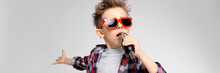A Handsome Boy In A Plaid Shir...