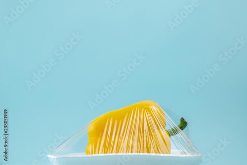 фотографія  Food in plastic wrap at blue background
