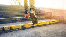 Man In Beautiful Brown Leather Shoes Walks The Granite Stairs In An Urban Environment. Blank Background. Life In Motion Concept