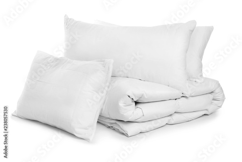 Photo Clean blanket and pillows on white background