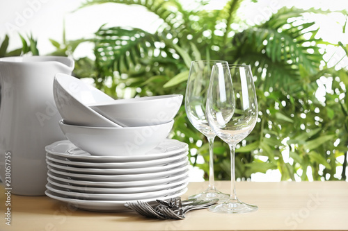 Set of clean dishes on blurred background