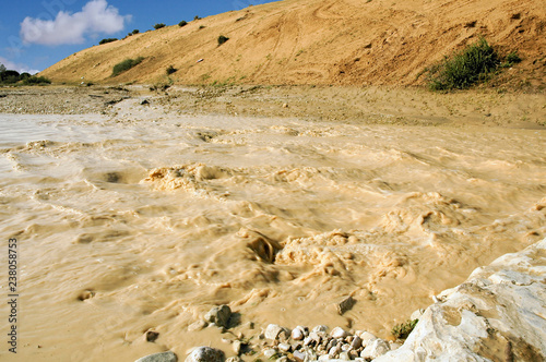 Flash flood in a desert river Canvas Print