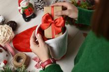 Female Hands Filling Christmas Stocking