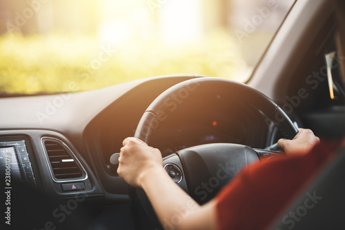 Cuadros en Lienzo  Close Up of Woman Driving a Car on Road - Transportation Concept