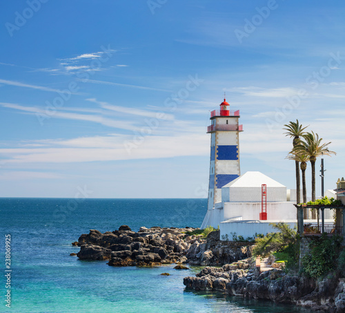 Fototapeten Leuchtturm Alone lighthouse on the rock in lagoon in Portugal