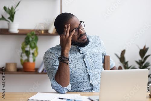 Serious african millennial businessman thinking cogitating about business issues Tapéta, Fotótapéta