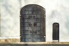 Large Metal Door And Small Metal Door