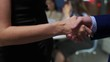 Handshake on the background of office staff.