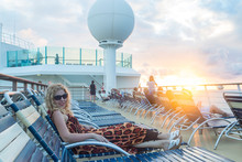 At Philipsburg, St Martin - December 1, 2016 : Blonde Woman Lying On Sunbed In Cruise Ship During Sunset.
