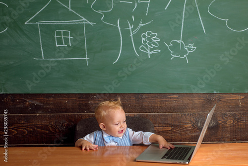 Little boy use free internet in computer class  Preschooler have