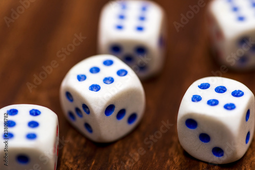 фотография  Five dice on a wooden desk. Five dice shows the six, what a luck