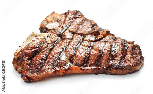 Fotoposter Steakhouse grilled meat on a plate isolated on white