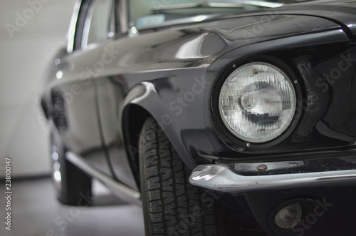 фотография  Front part of a retro vintage car in the garage