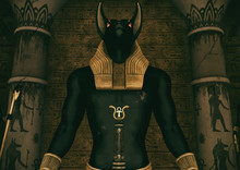 A Scene With A Close-up View Of A Huge Statue Of The Egyptian God Anubis.