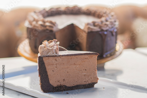 Fotografie, Obraz  Mocha cheesecake with chocolate and coffee whipped cream on top