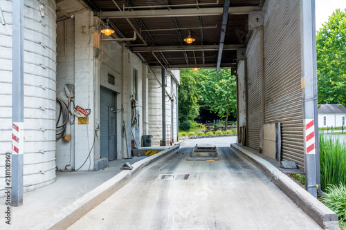 Truck receiving and delivery area at an industrial site Canvas Print