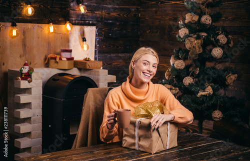 Fototapety, obrazy: Having fun. True Emotions. Positive human emotions facial expressions. Cute young woman with santa hat. Happy new year. Smiling woman decorating Christmas tree at home.