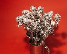 Christmas Decoration With Silver Roses On Red Background