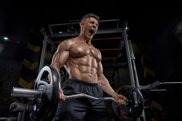 Muscular man working out in...