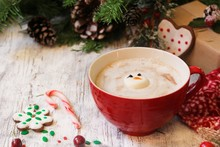 Marshmallow Sonwman In A Red Mug With Hotchocolate On Festive X-mas Background