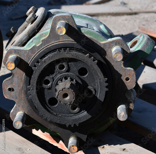 Poster Motocyclette spare parts of a gear wheel on hydraulic tractor gear pump