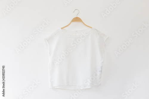 White blouse is clothes hanging on white background. Canvas Print