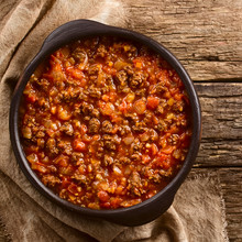 Homemade Vegan Bolognese Sauce Made With Soy Meat, Fresh Tomatoes, Onion And Garlic, Served In Rustic Bowl, Photographed Overhead On Rustic Wood (Selective Focus, Focus On The Sauce)