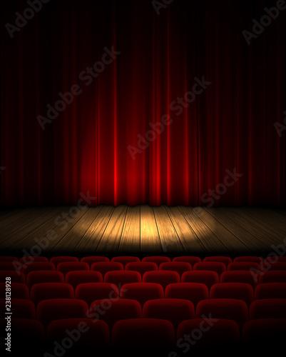 Carta da parati  Illuminated theater stage with a red curtain