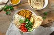 Healthy Vegan food vegetarian buddha bowl naan bread wooden table top view