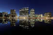 Oakland skyline panoramic view with Lake Merritt Reflections at blue hours. Oakland, Alameda County, California, USA.