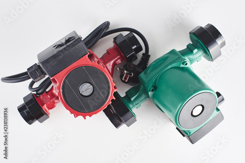 Red and green circulation pumps for heating on a white background Fototapet