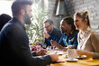 canvas print picture - Happy young friends hangout in coffee shop