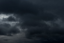 Beautiful Grey Fluffy Rain Clouds. Cloudscape After Bad Weather. Autumn Dark Storm Clouds Over Black Sky.