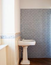 Detail Of A Porcelain Sink With Light Blue Tiles