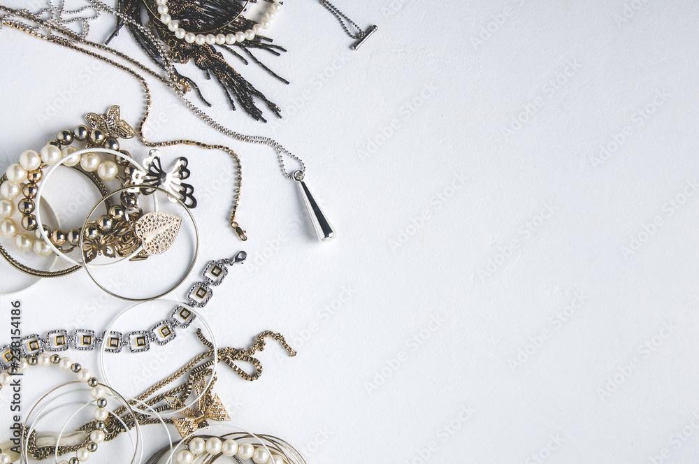 Fototapety, obrazy: Women's jewelry on white background