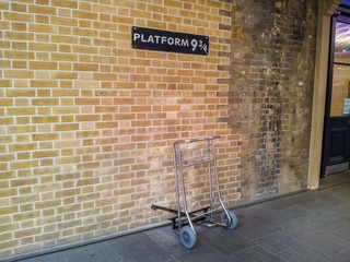 Baggage trolley at the Platform 9 and 3/4 at Kings Cross Station, London.