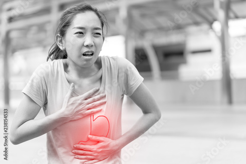 Fototapeta  Asian woman Suffering from stomach painful or Acid Reflux or Heartburn,Gas,Bloating,Belching and flatulence or gastrointestinal system disease