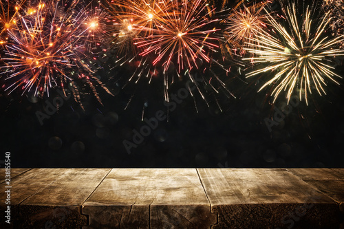 Empty wooden table in front of fireworks background. Product display montage.