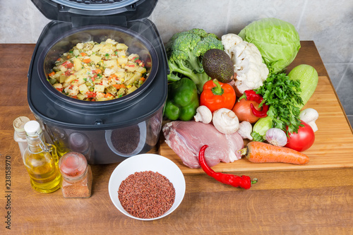 Vegetables braised in household multi-cooker among of raw foods