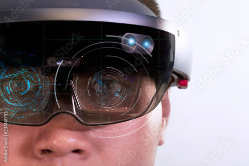 Portrait of young man with 3D virtual reality glasses hololens on white backgrou Wallpaper Mural