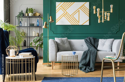 Fototapeta Golden, green and grey accents in contemporary living room interior obraz