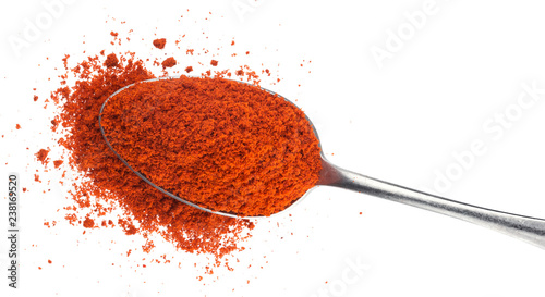 Ground red paprika in spoon isolated on white background Fototapeta