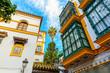 canvas print picture - historic buildings in Santa Cruz, Seville, Spain