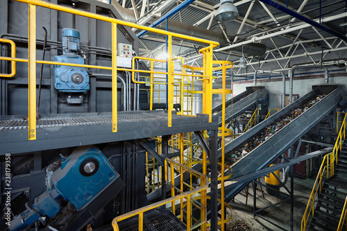 Fotografia, Obraz  Refiner and chain-stepped conveyor equipment of modern waste recycling plant tra